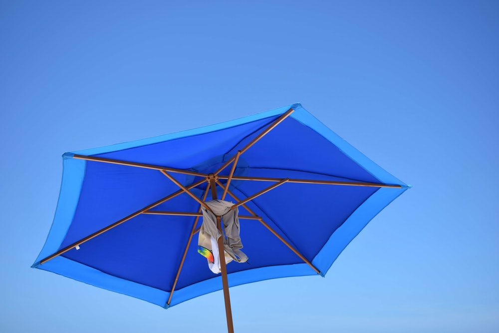 blue and brown patio umbrella during daytime