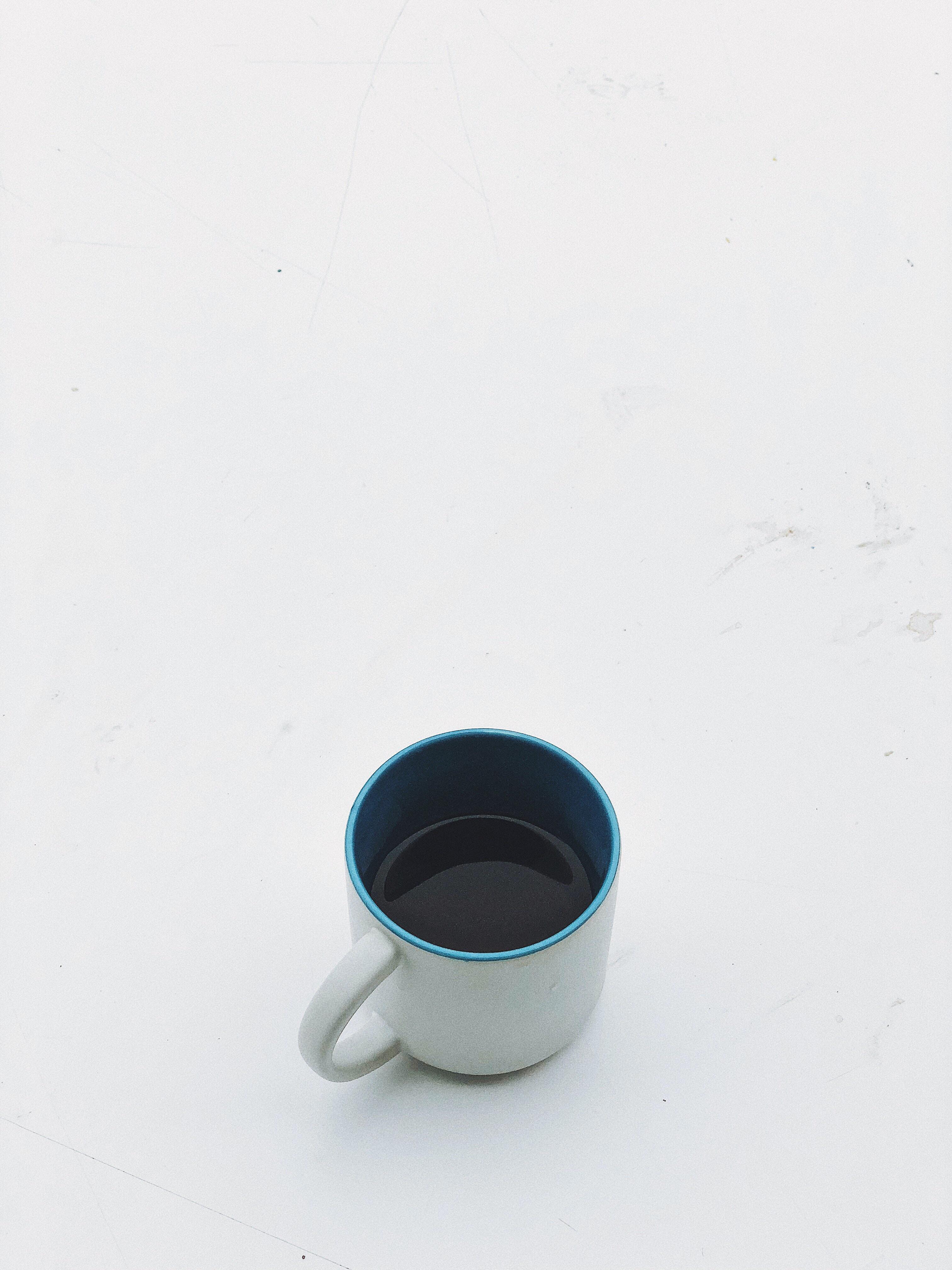 half filled black coffee