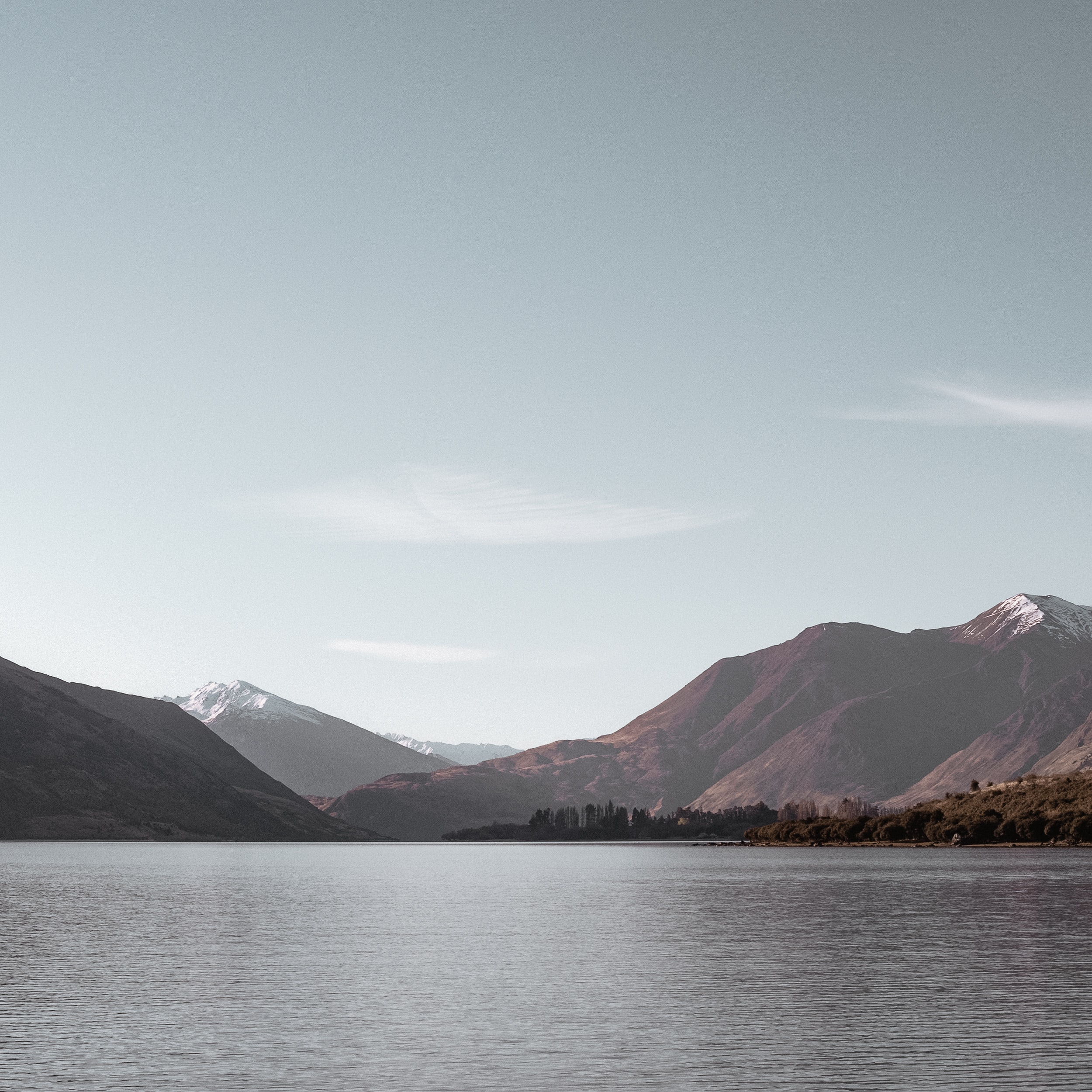 landscape photography of body of water with mountains