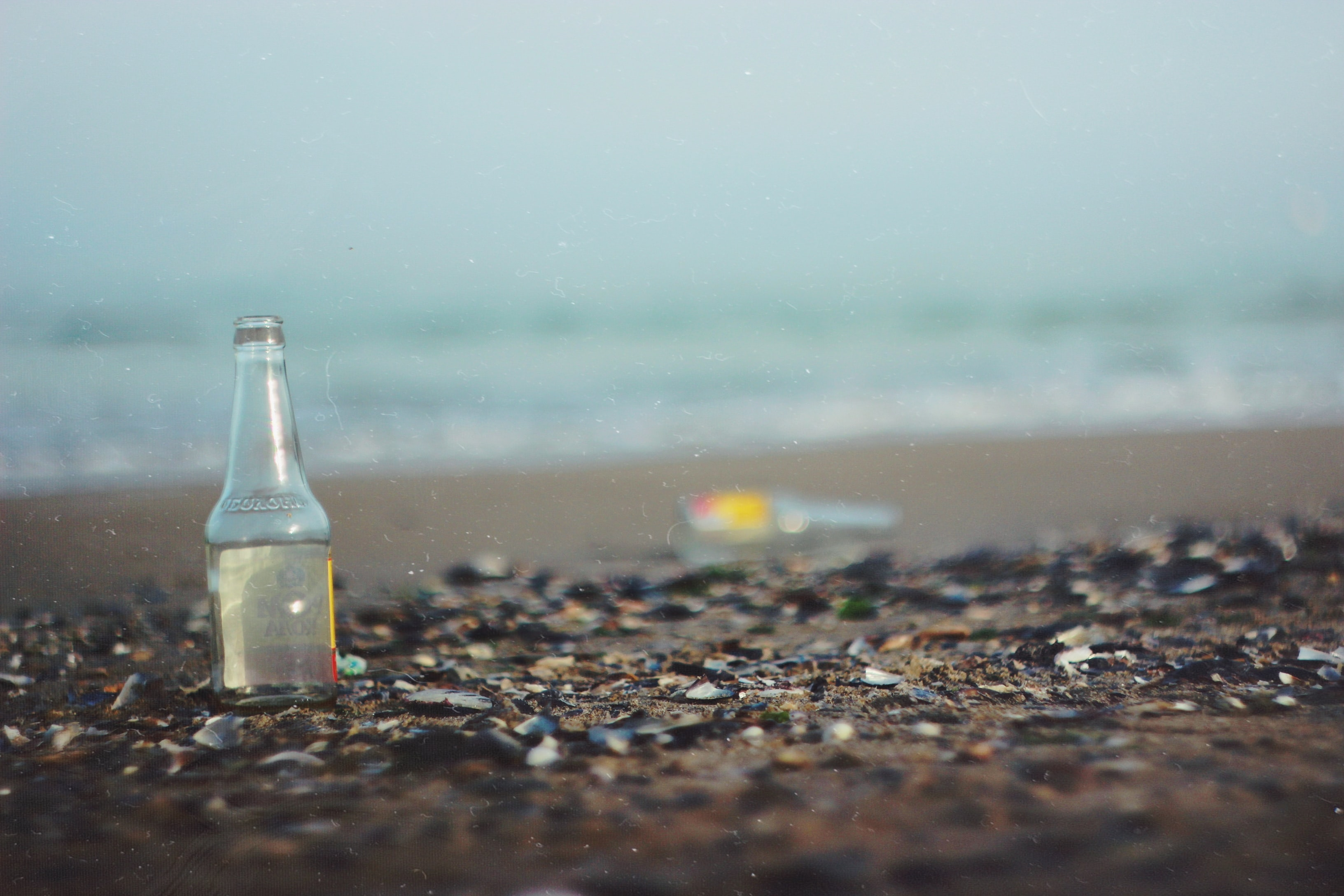 glass bottle on sea shore