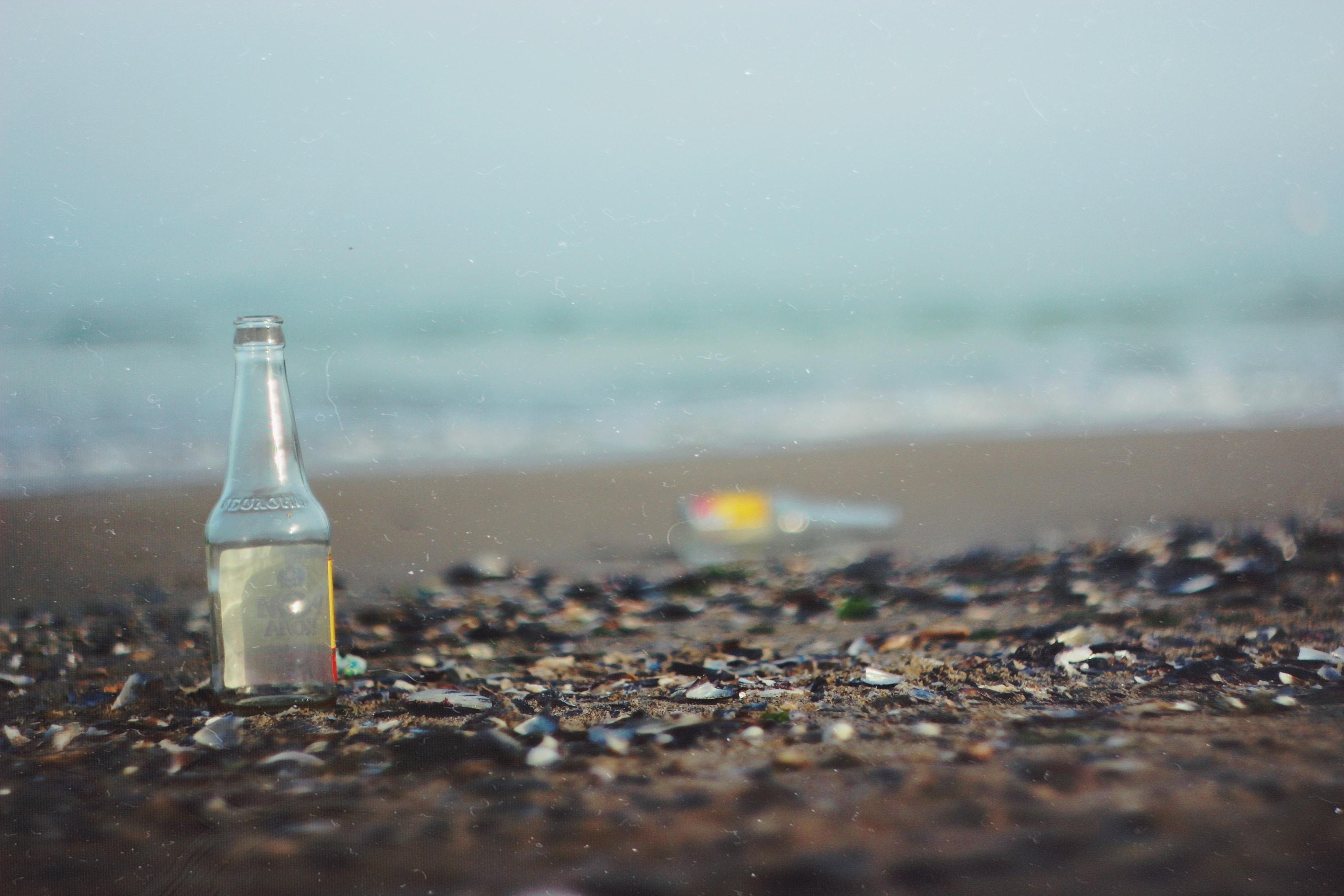 glass bottle on sea shore