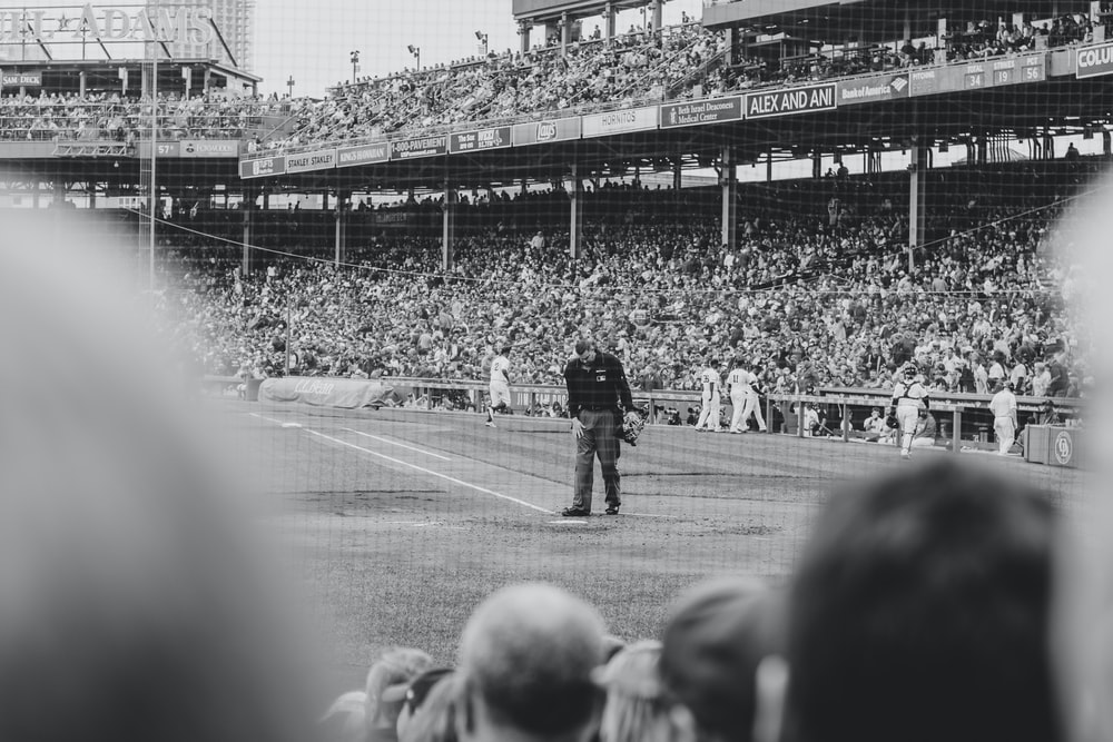 grayscale photography of people playing baseball