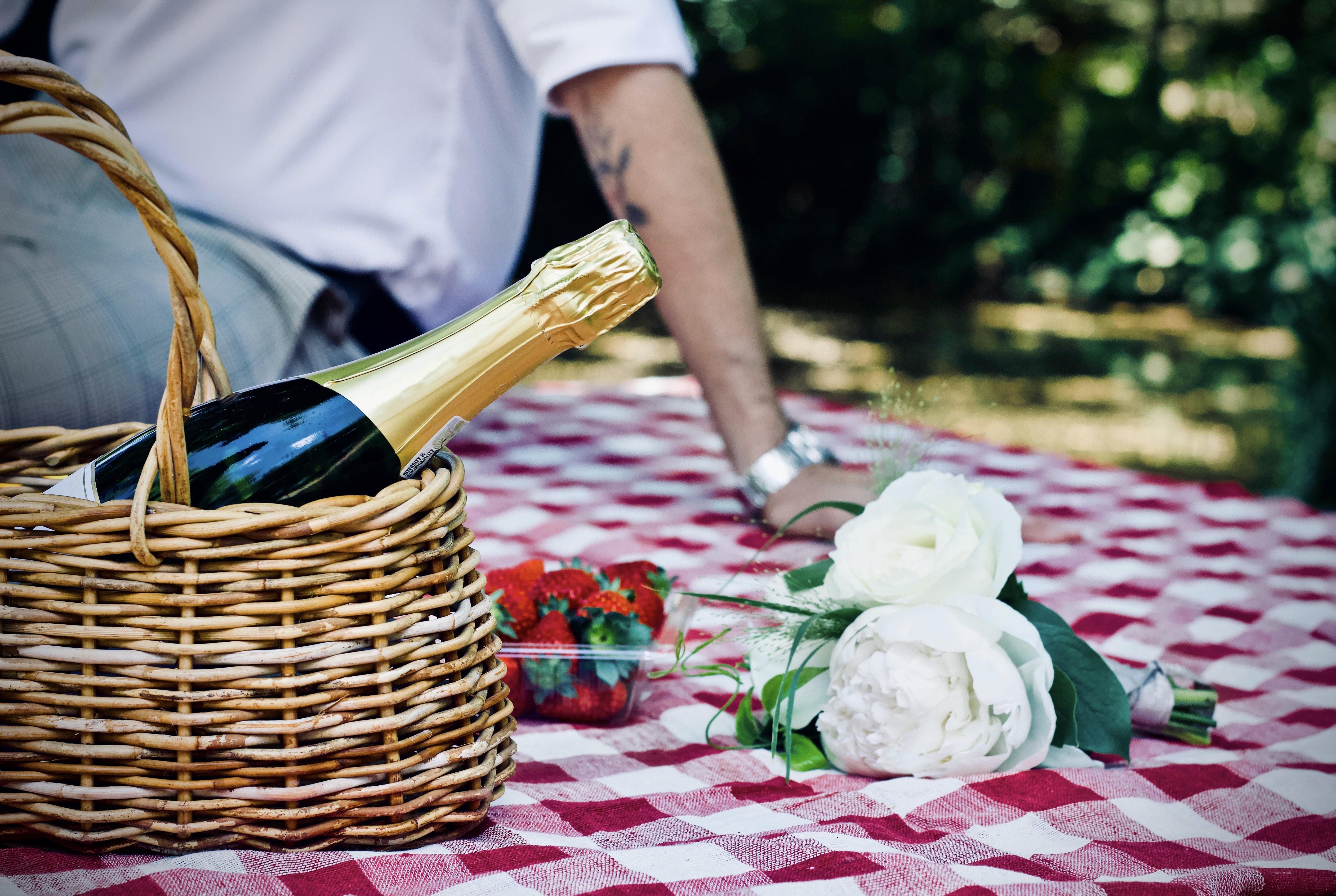 white petaled flower beside basket