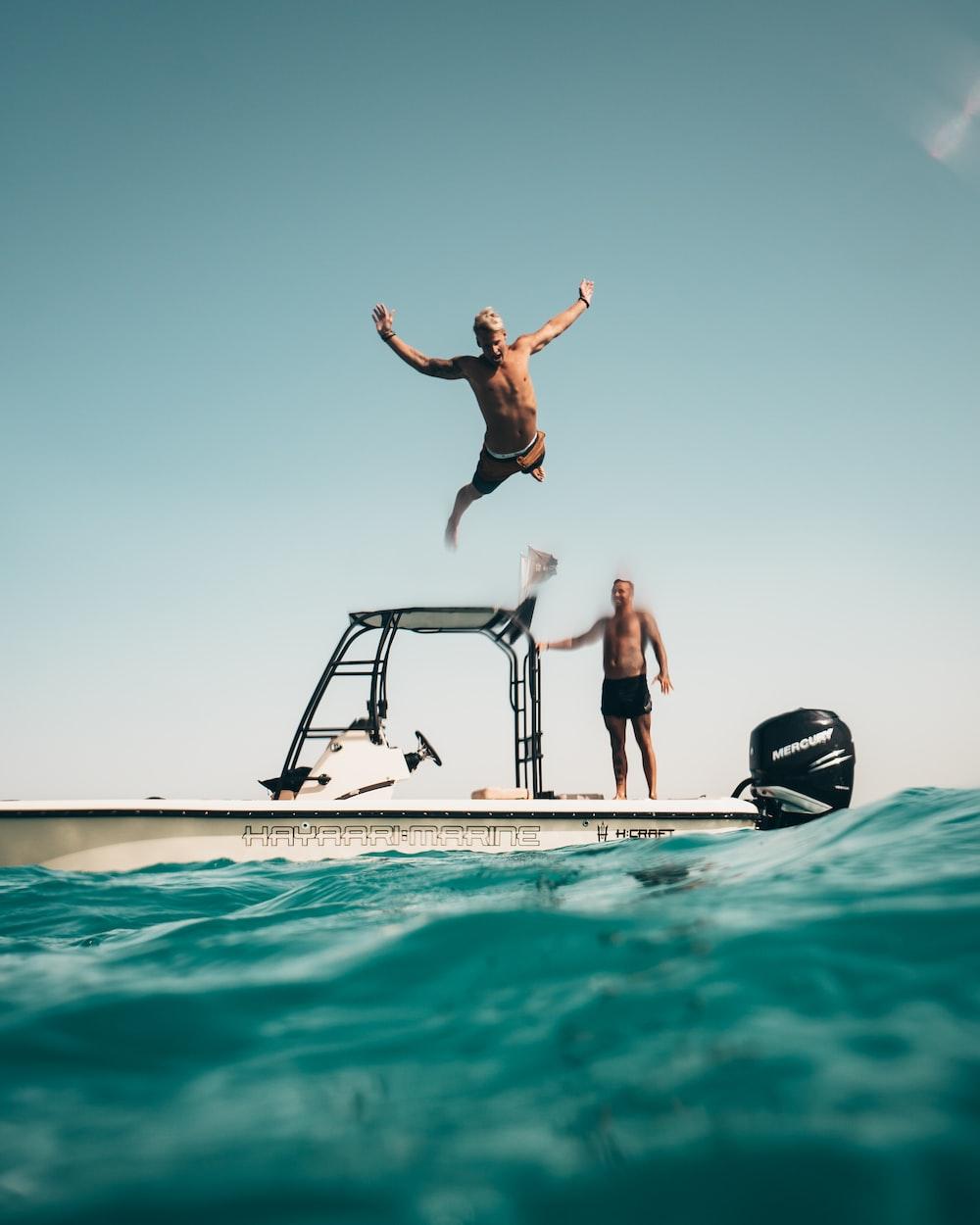 man diving on pool