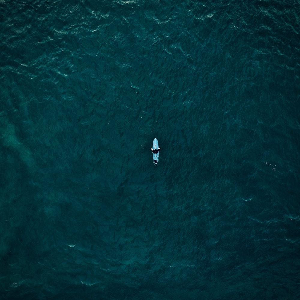 aerial view of person riding kayak boat