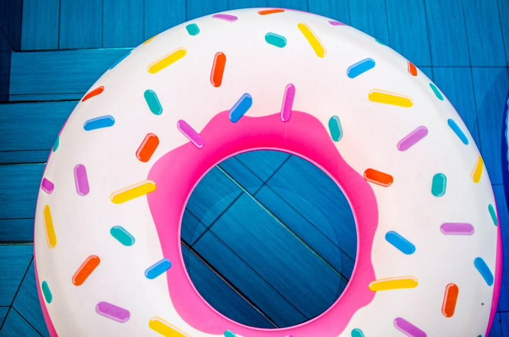 yellow and pink doughnut floater
