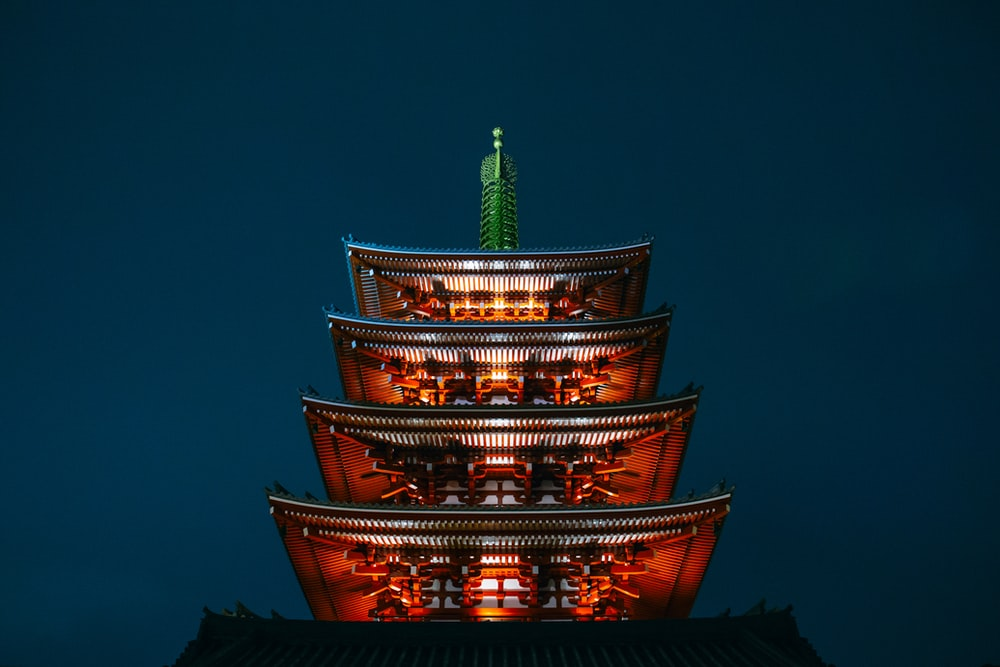 photo of red pagoda during nighttime