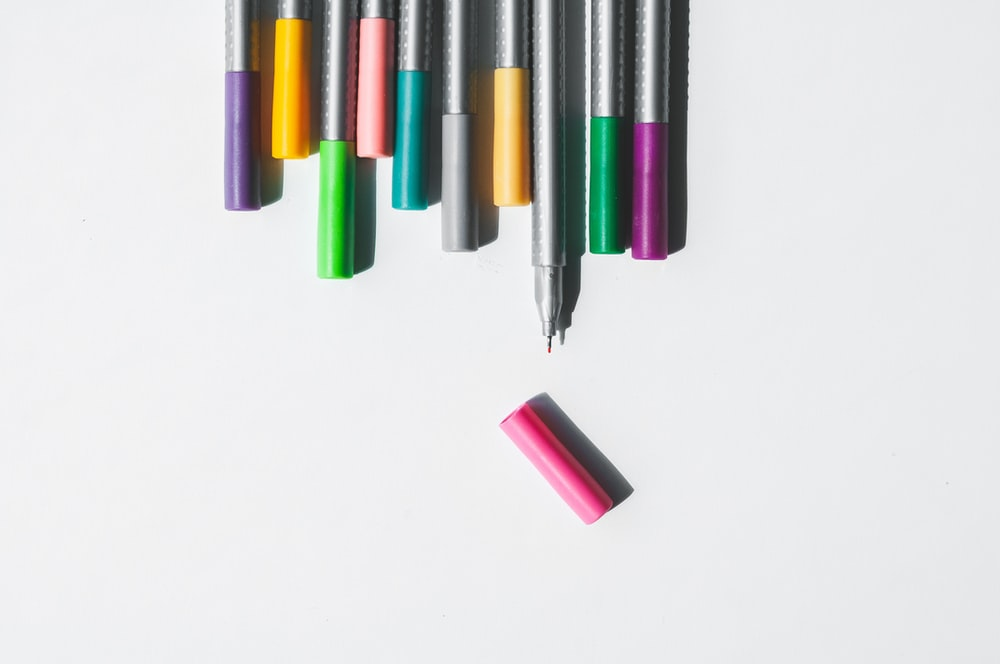 assorted-color on pens on white background