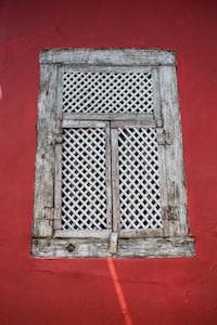close-up photo of gray wooden door windows