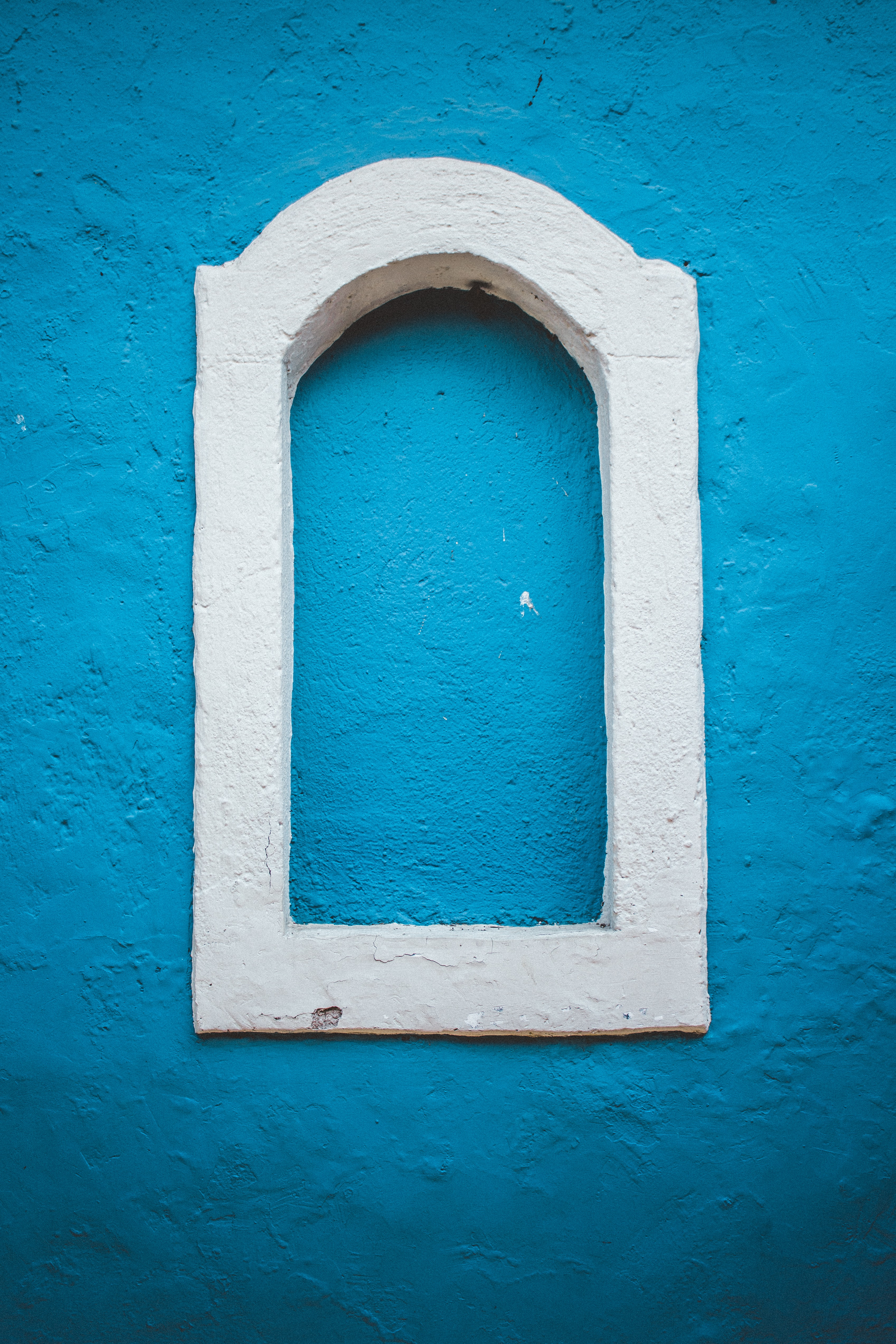 white arch framed wall decor
