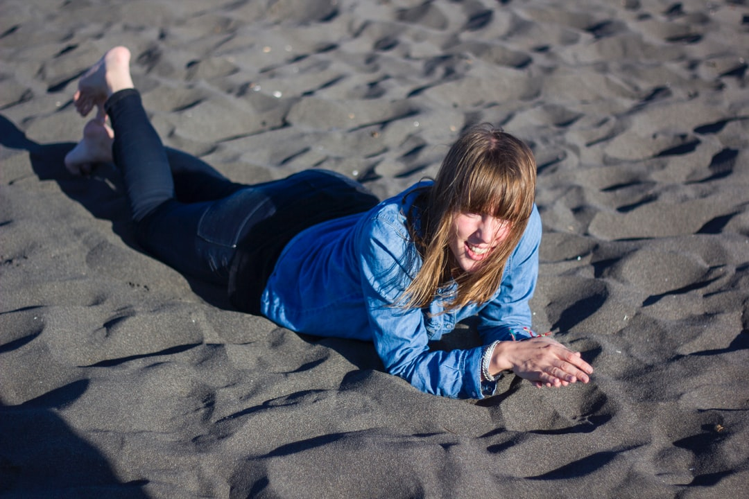 She is my friend Mathilde from France. We do this journey to Pichilemu beach with friends, and she just fall down the sand and enjoy the moment.