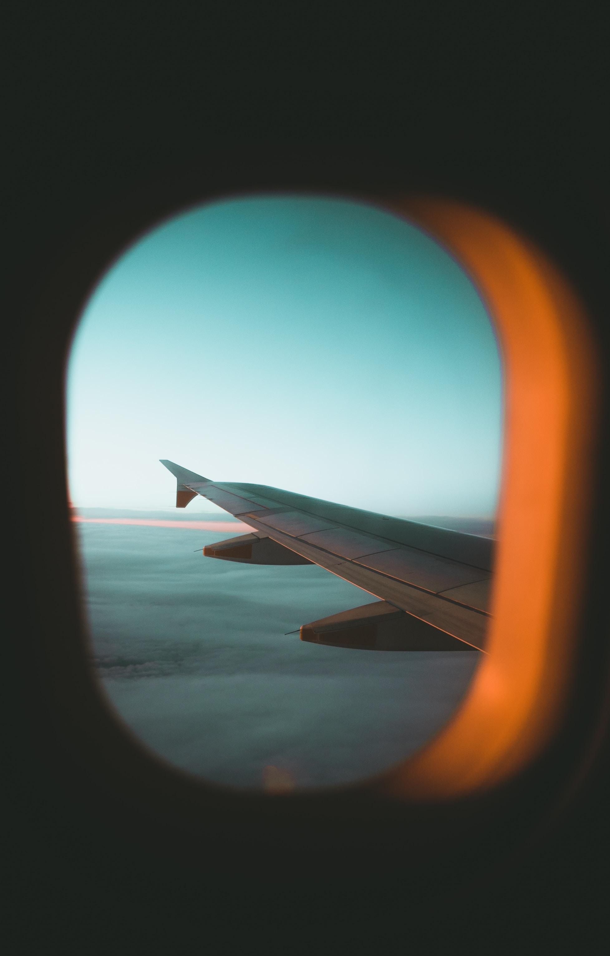 plane wing through glass window