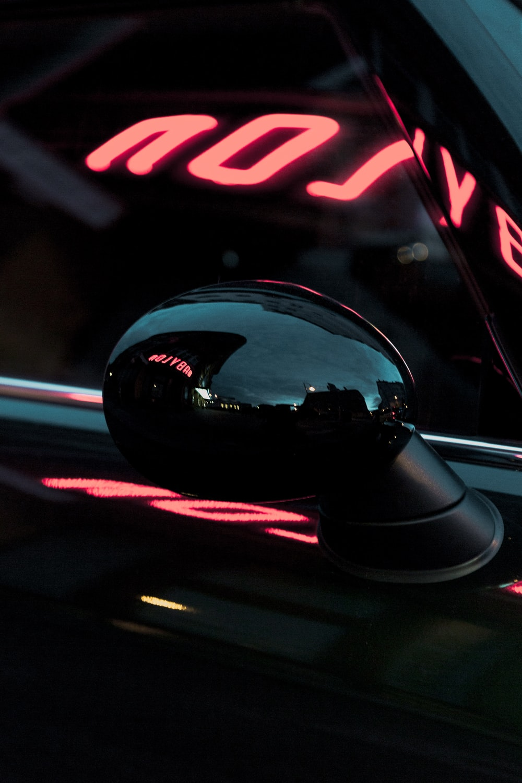 black vehicle wing mirror during nighttime
