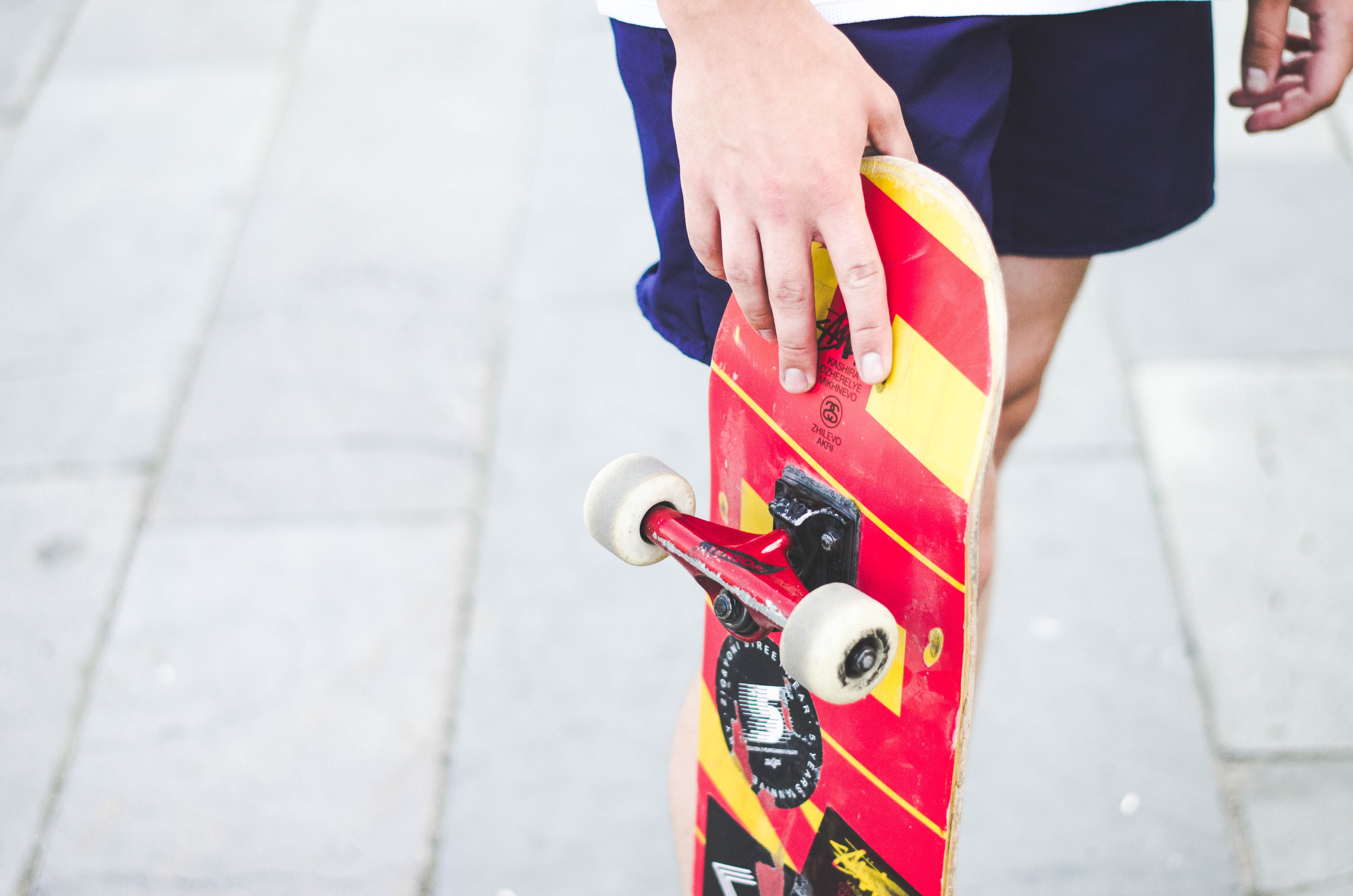 person holding skateboard