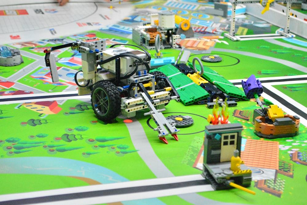 remote control toy car on green car track