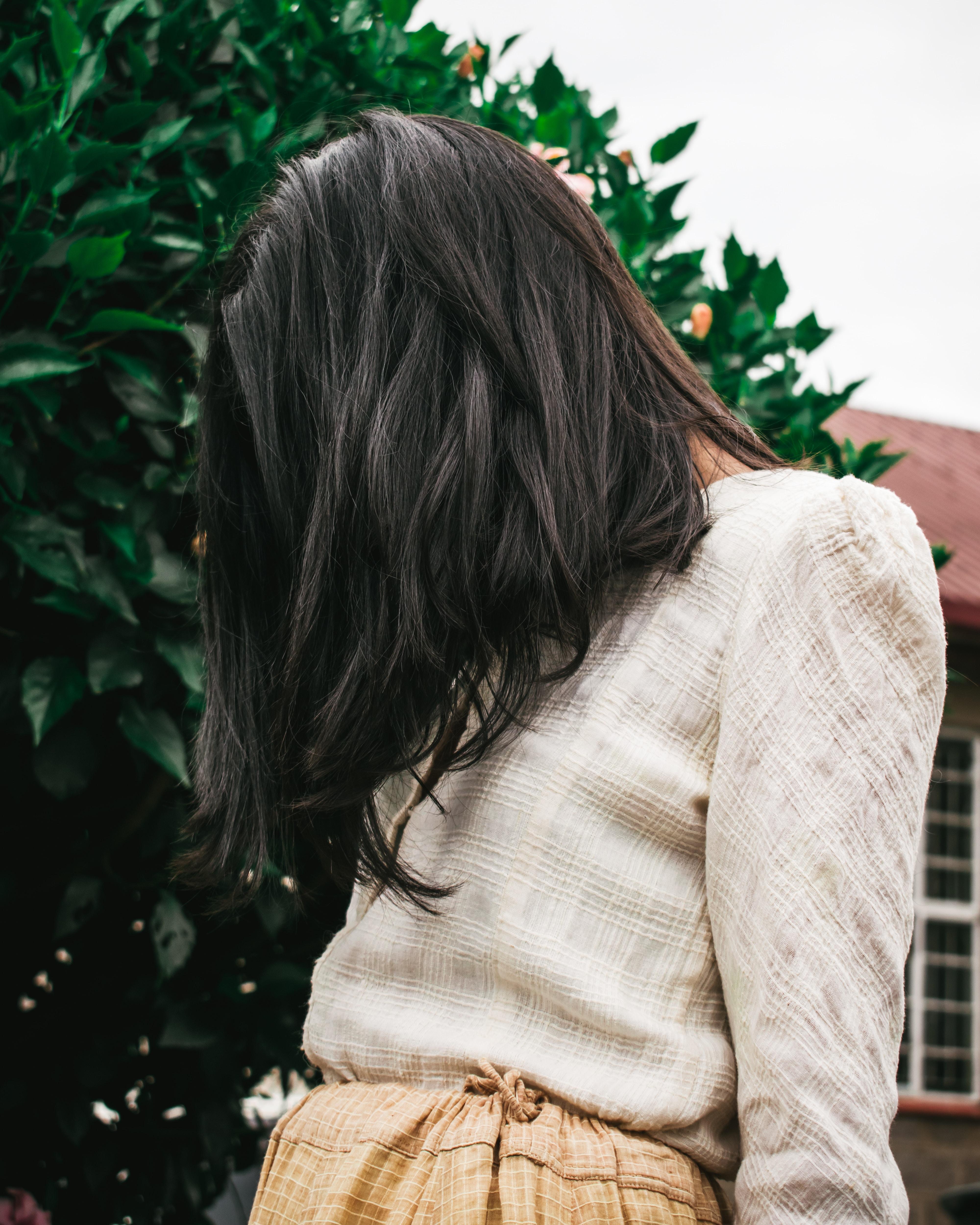 woman in beige long-sleeved top