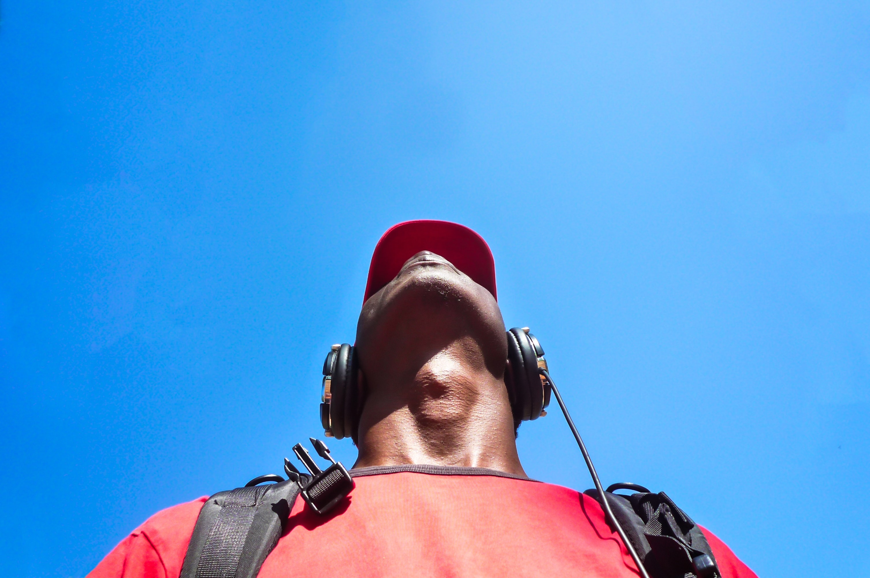 man looking up while wearing black headphones
