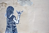girl holding paper boat illustration art