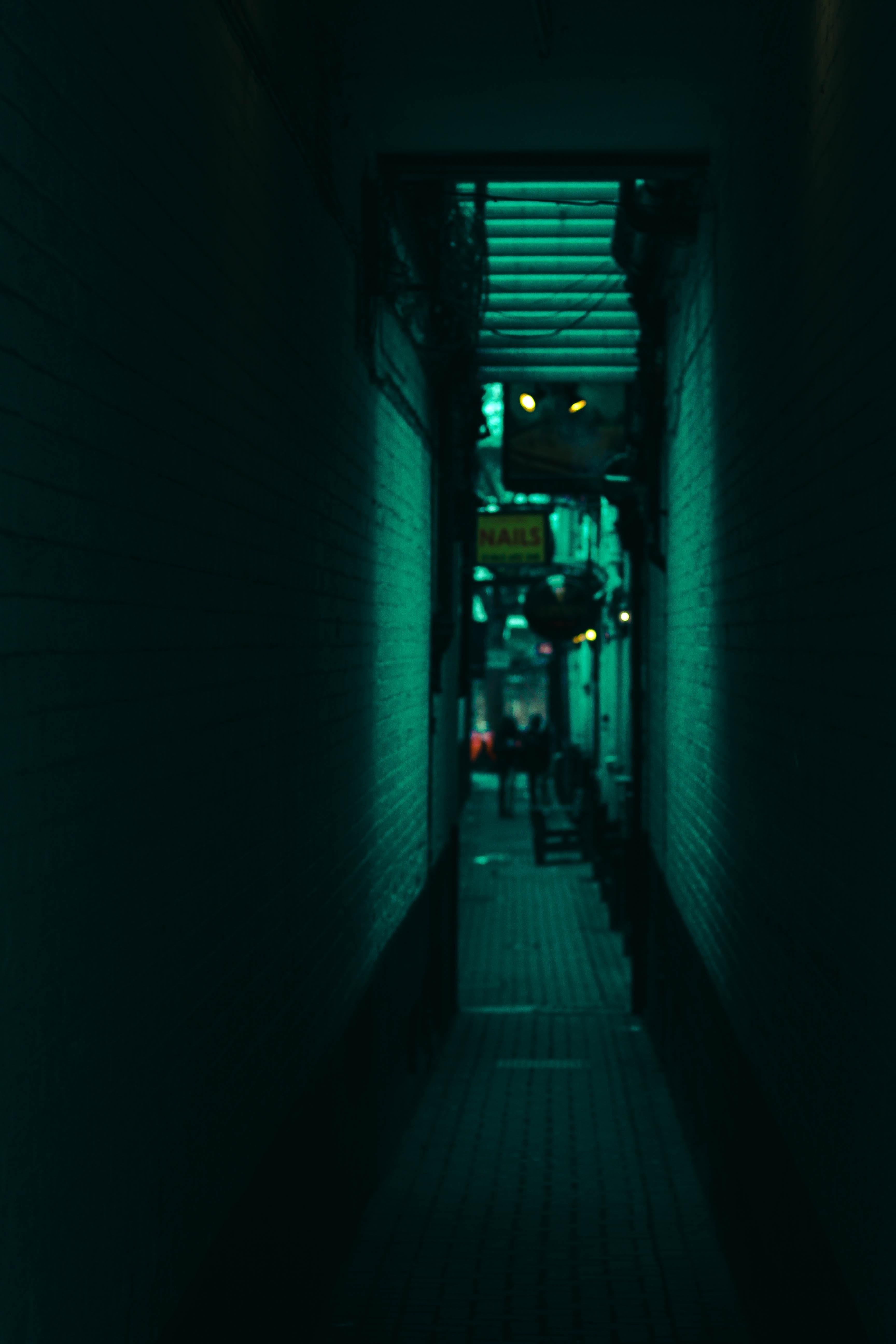 pathway between concrete buildings