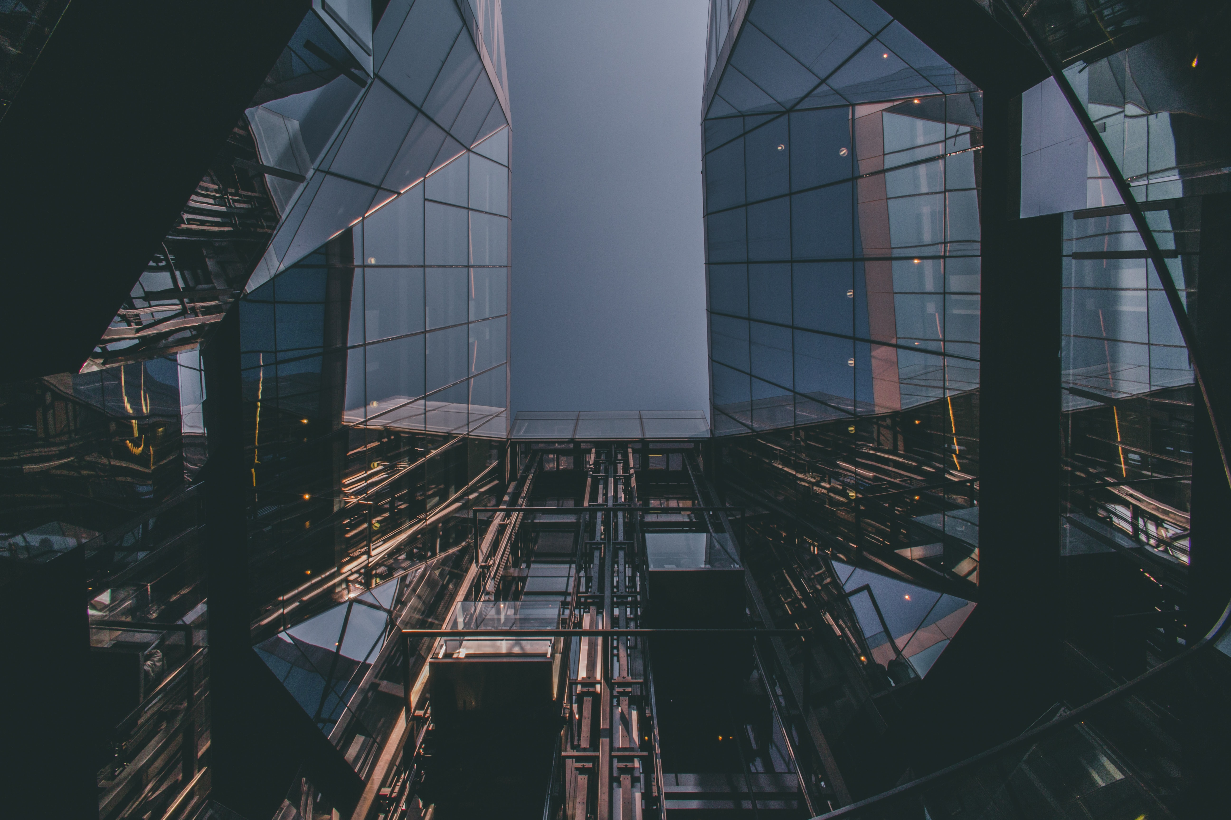 low angle photography of mirrored building