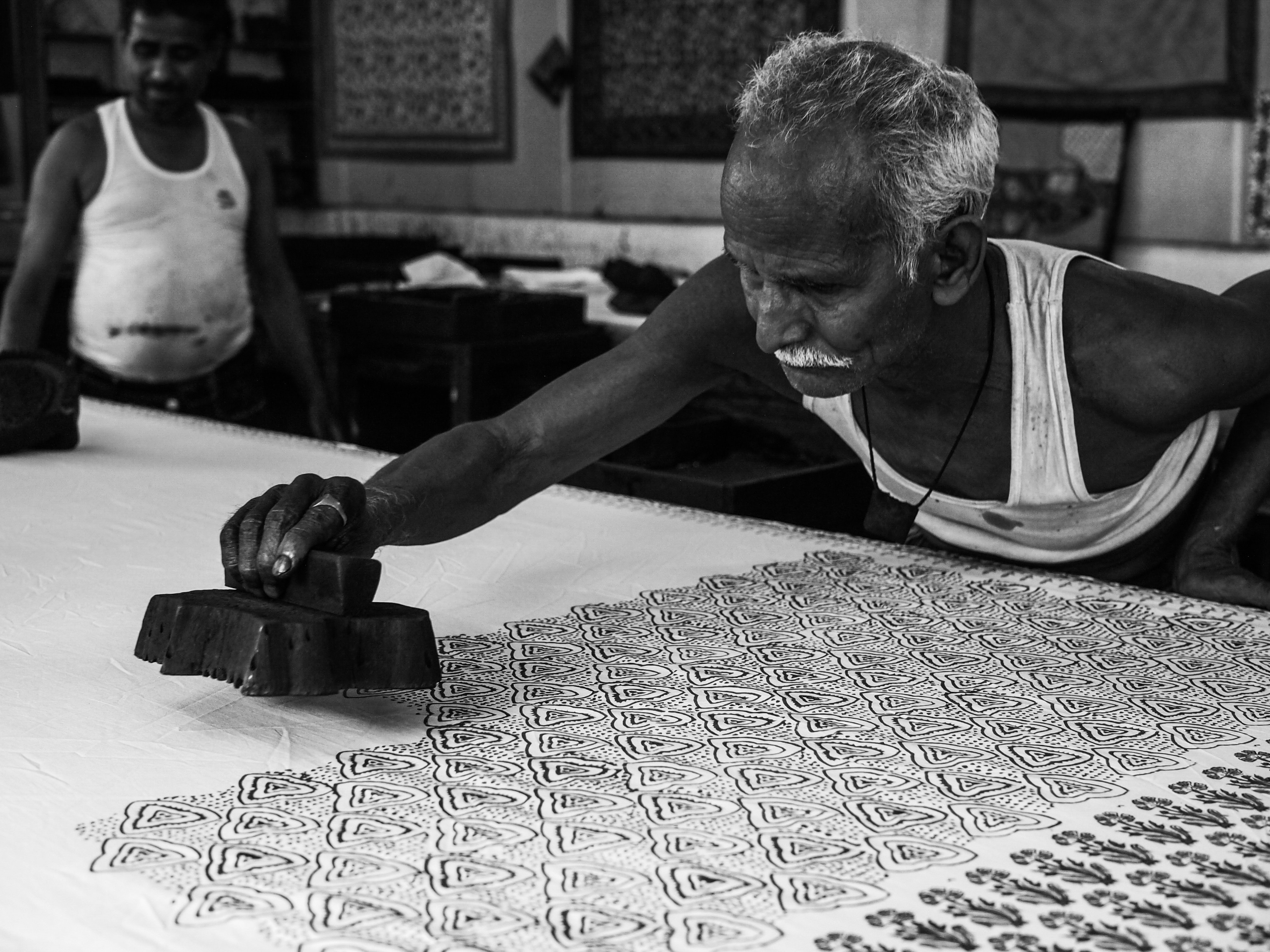 man stamping on white surface grayscale photography