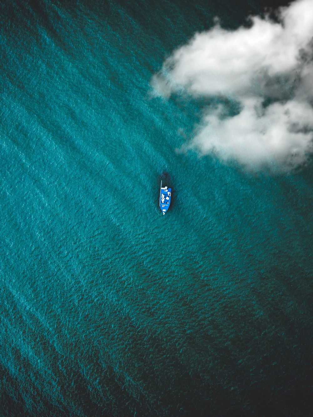 top view photo of boat on body of water