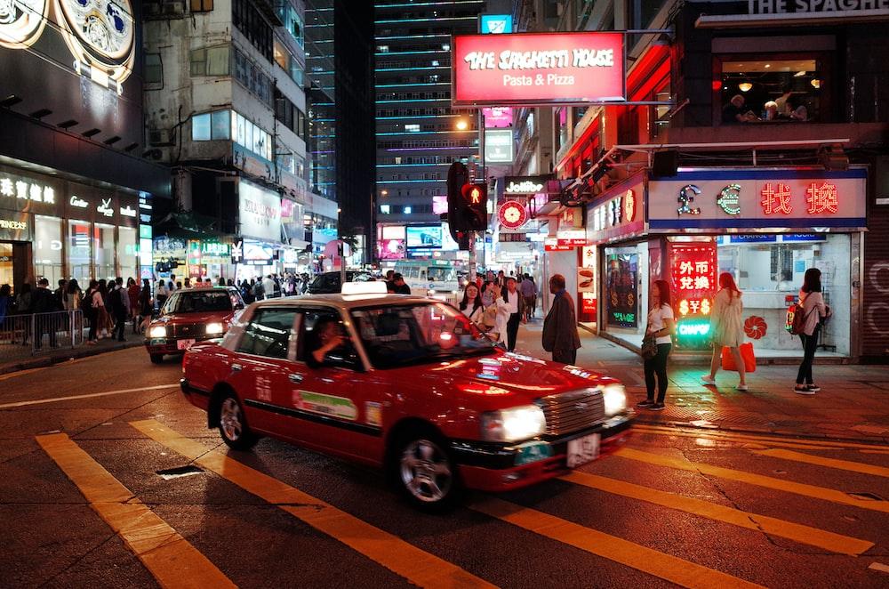 red sedan on city