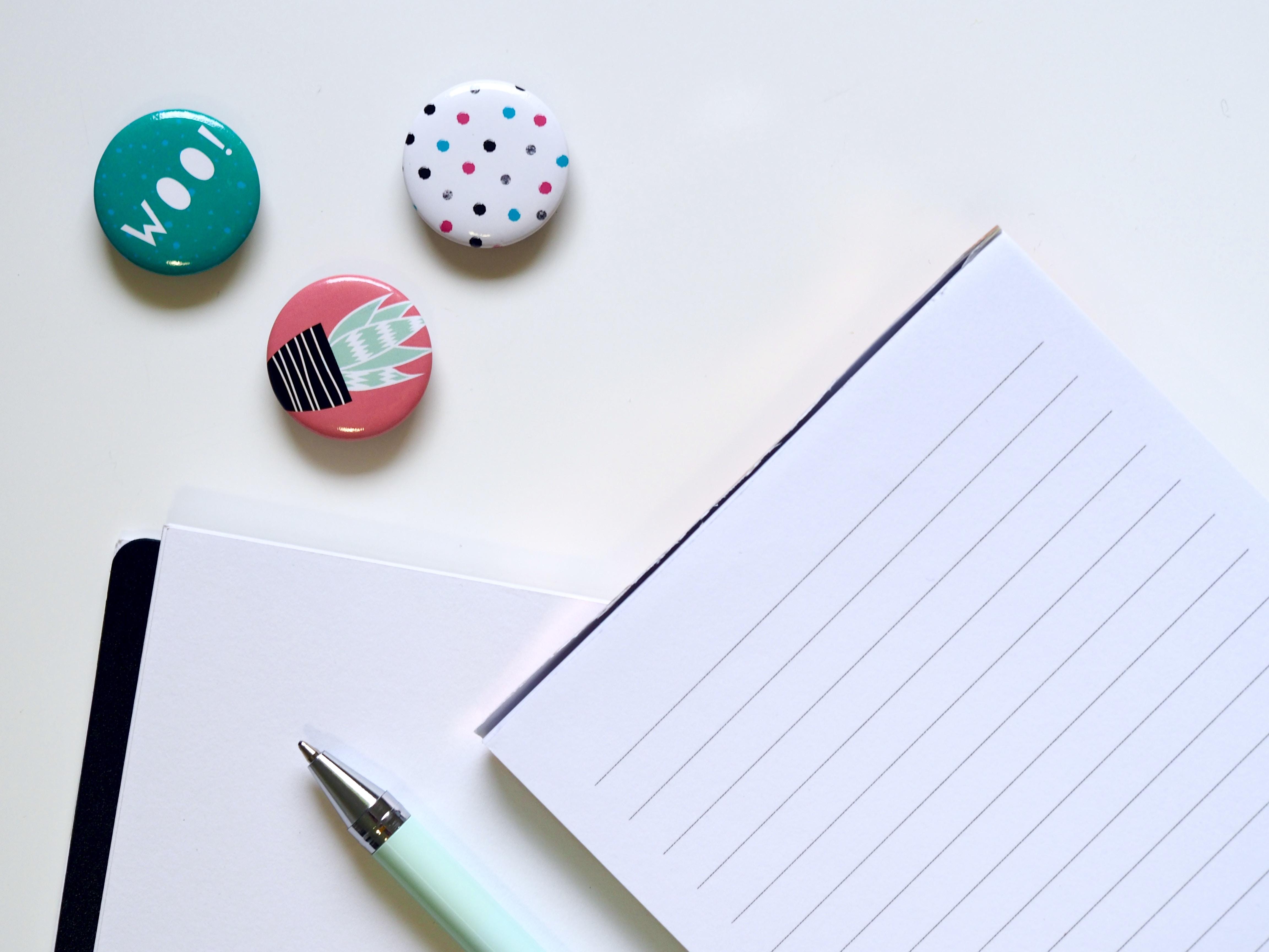 pen beside ruled paper