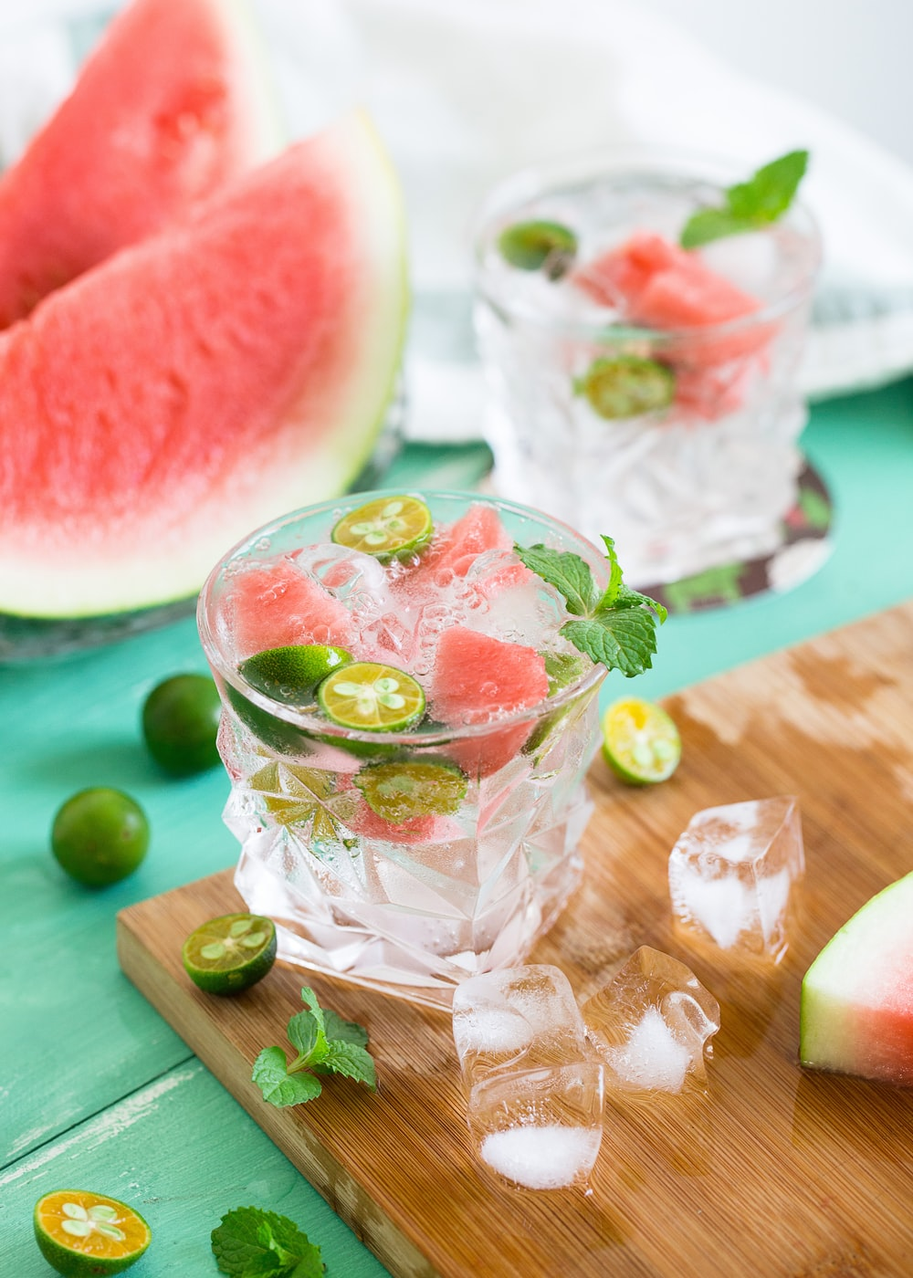 sliced watermelon with lemon on shot glass