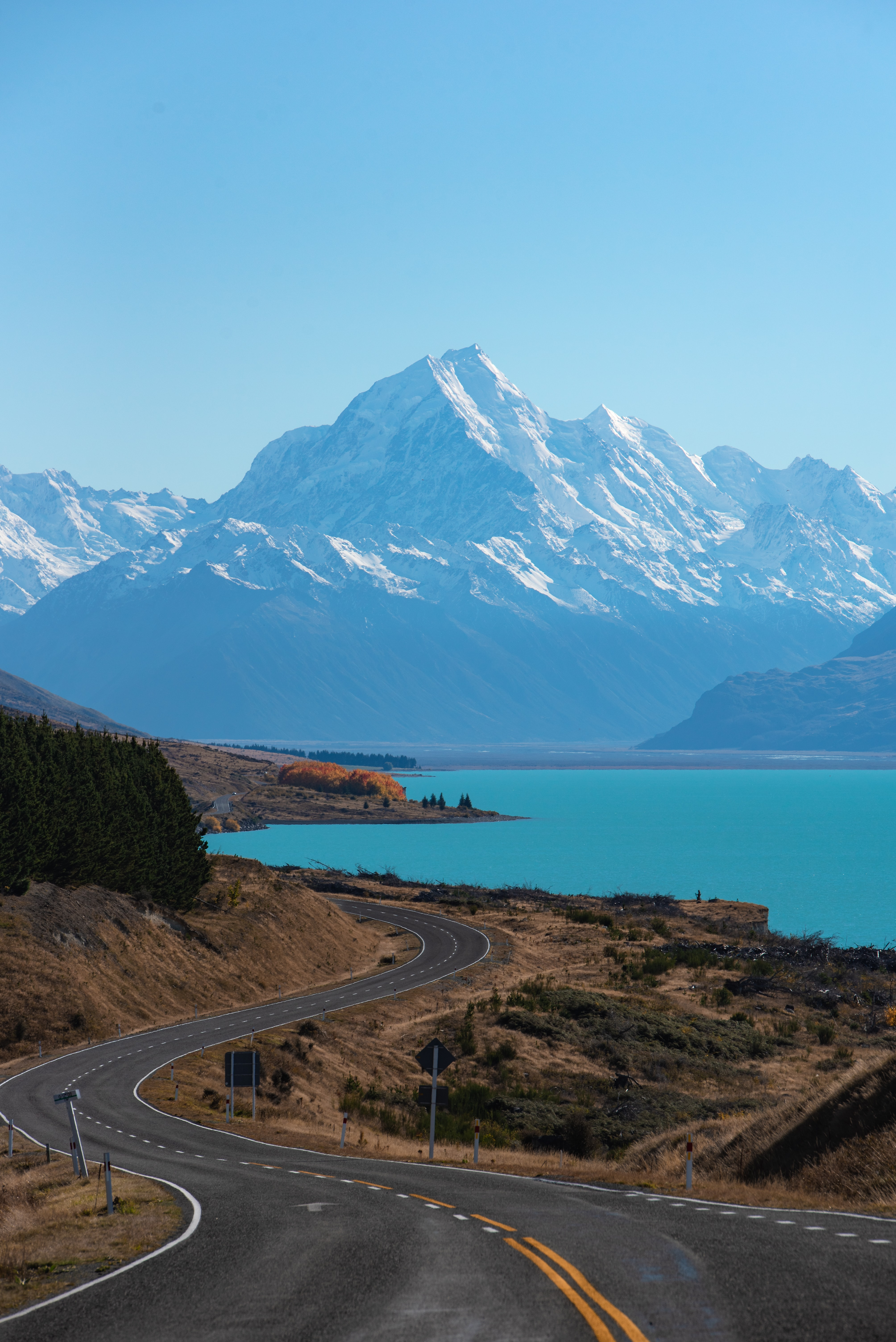 road towards snow capped mountain