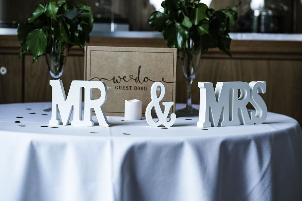 white Mr & Mrs freestanding letters on table with white spread