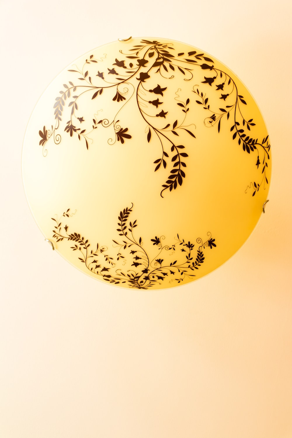 round yellow and black ornament