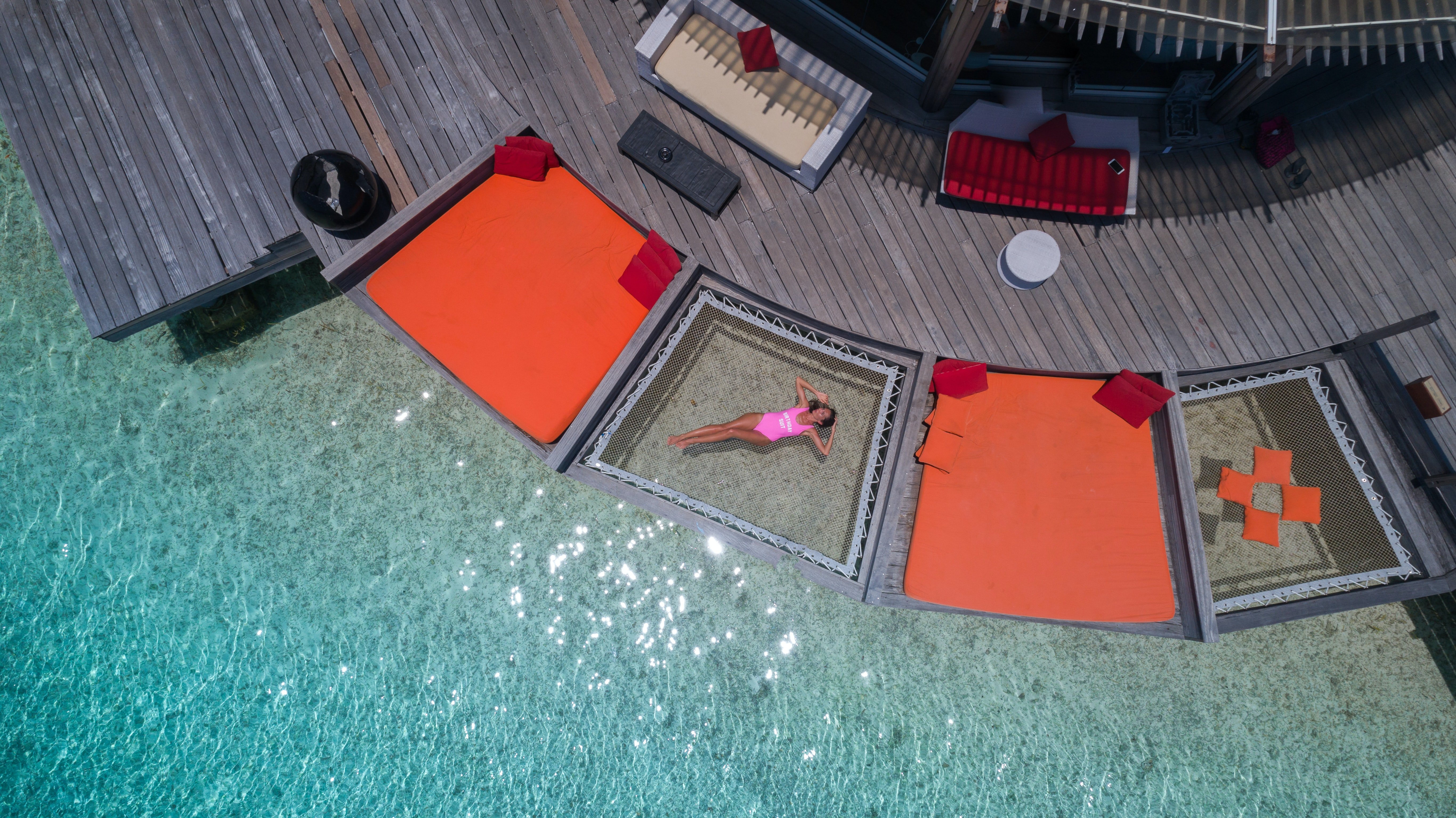 aerial view photography of woman floating on body of water