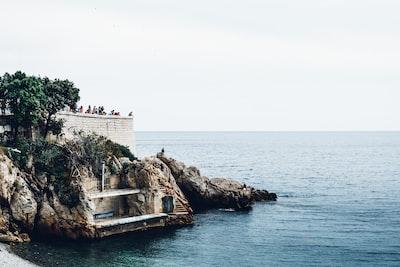 rocky seashore with platform mediterranean teams background