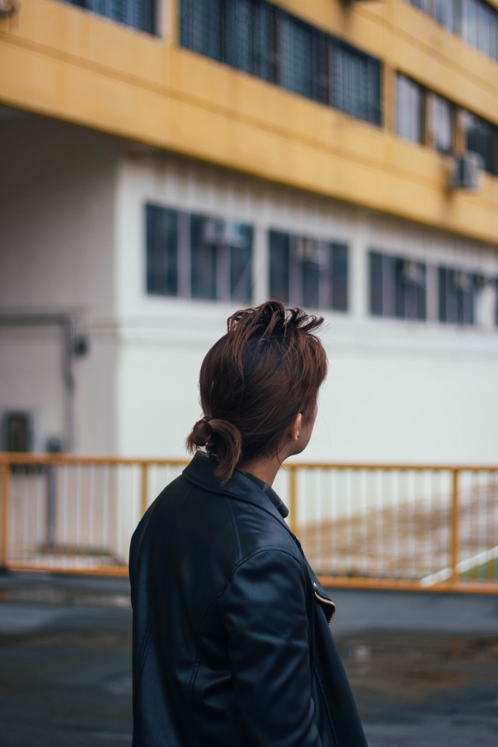 selective focus photography of woman wear black leather jacket