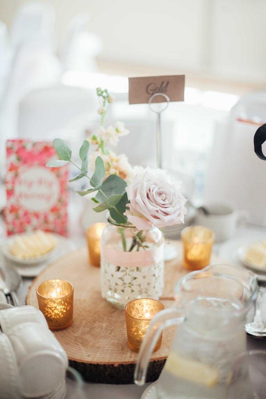 pink rose flower with glass pot centerpiece