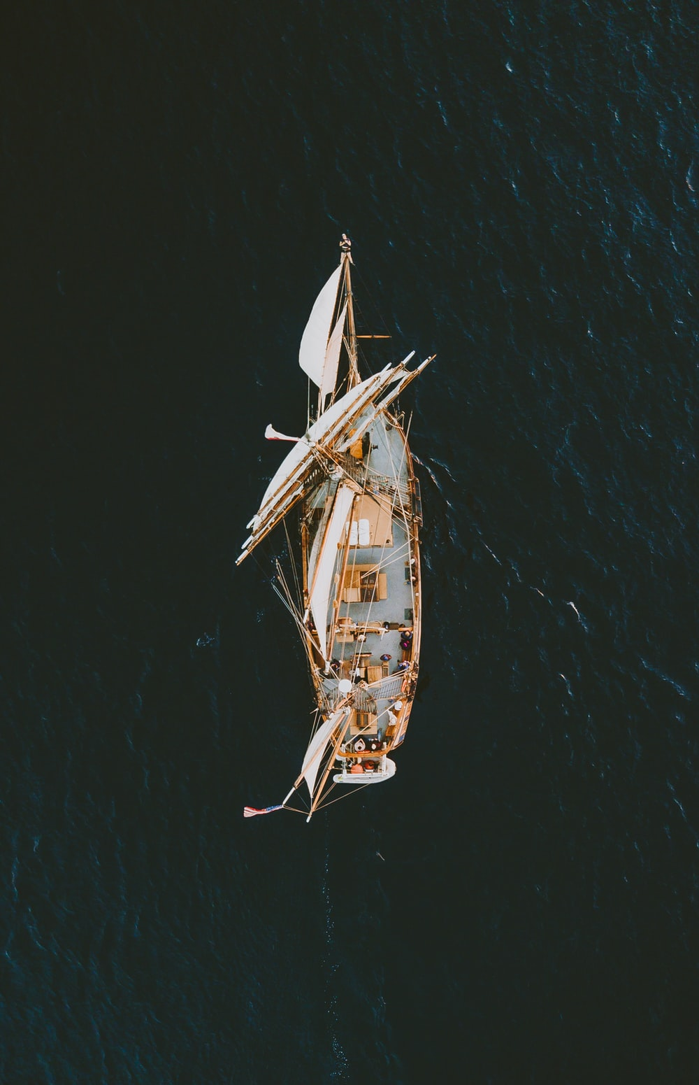 aerial photography of brown galleon ship on body of water