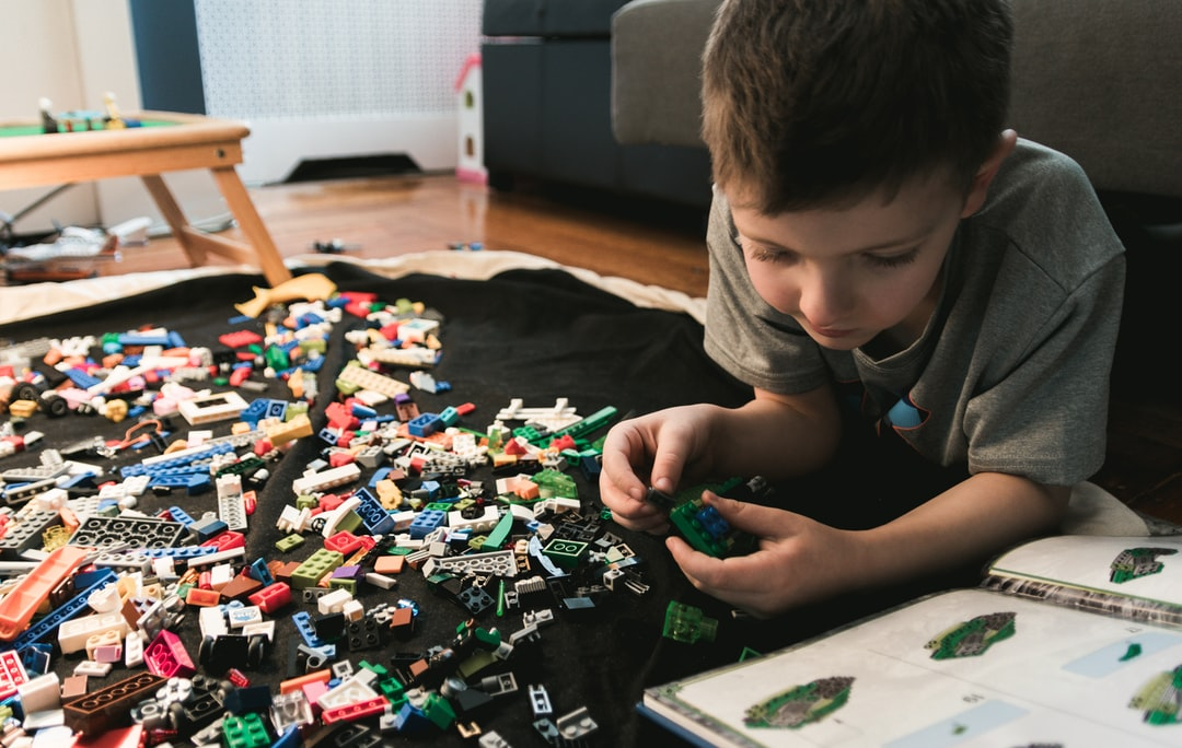Making lego creations from an inspiration book