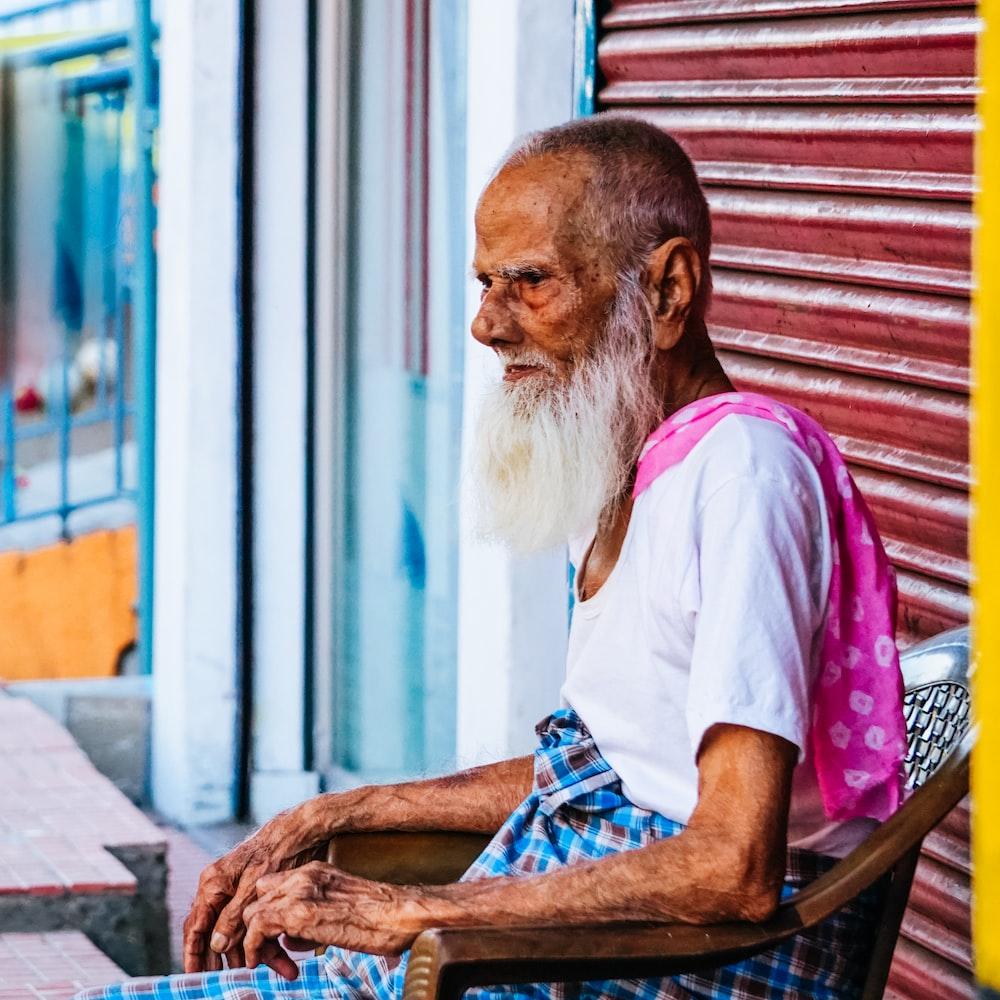 man sitting on armchair during daytime