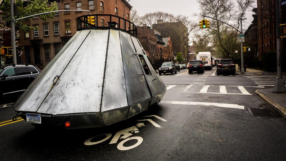 gray metal vehicle on road during daytime