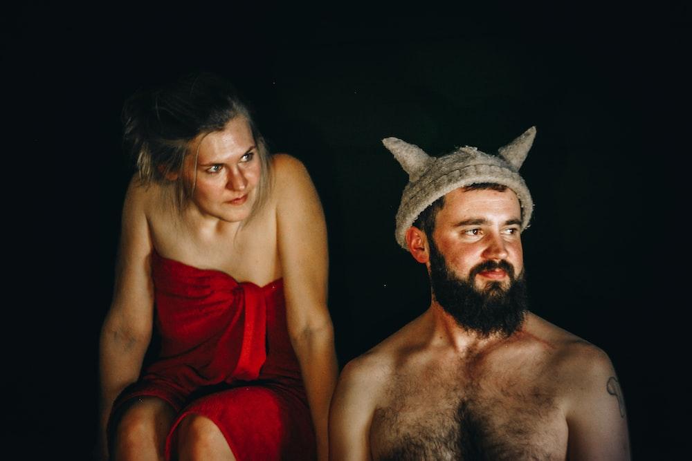 topless man near woman look at him