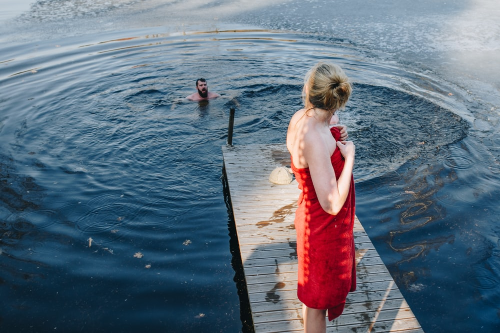 woman standing on gray dock