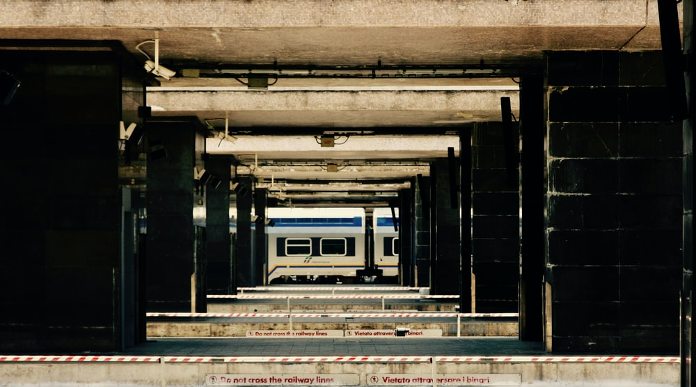 photo of gray concrete train station at daytime