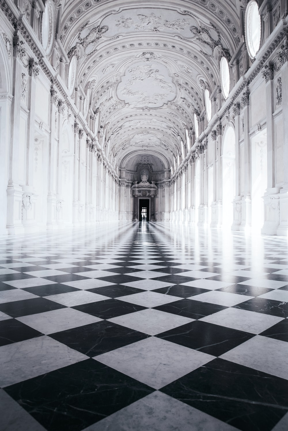 one-point perspective photography of building's interior