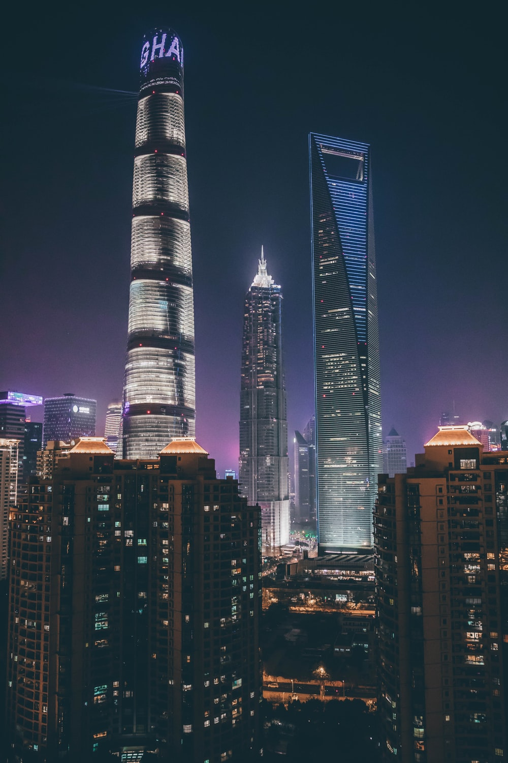 photography of lighted high-rise buildings