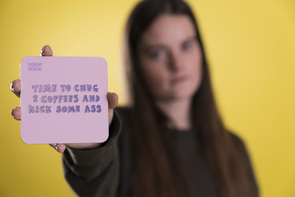 woman holding purple card