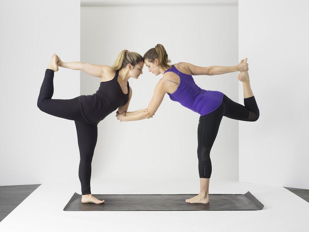 two women doing yoga