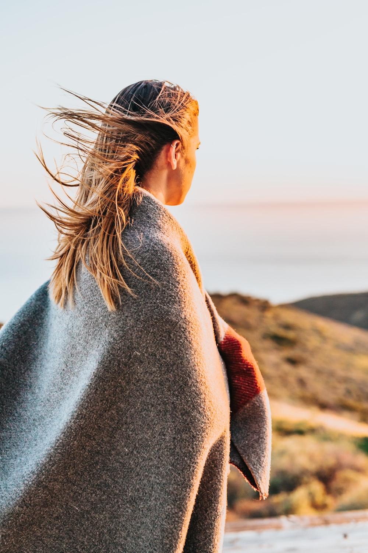 woman standing near sea shore