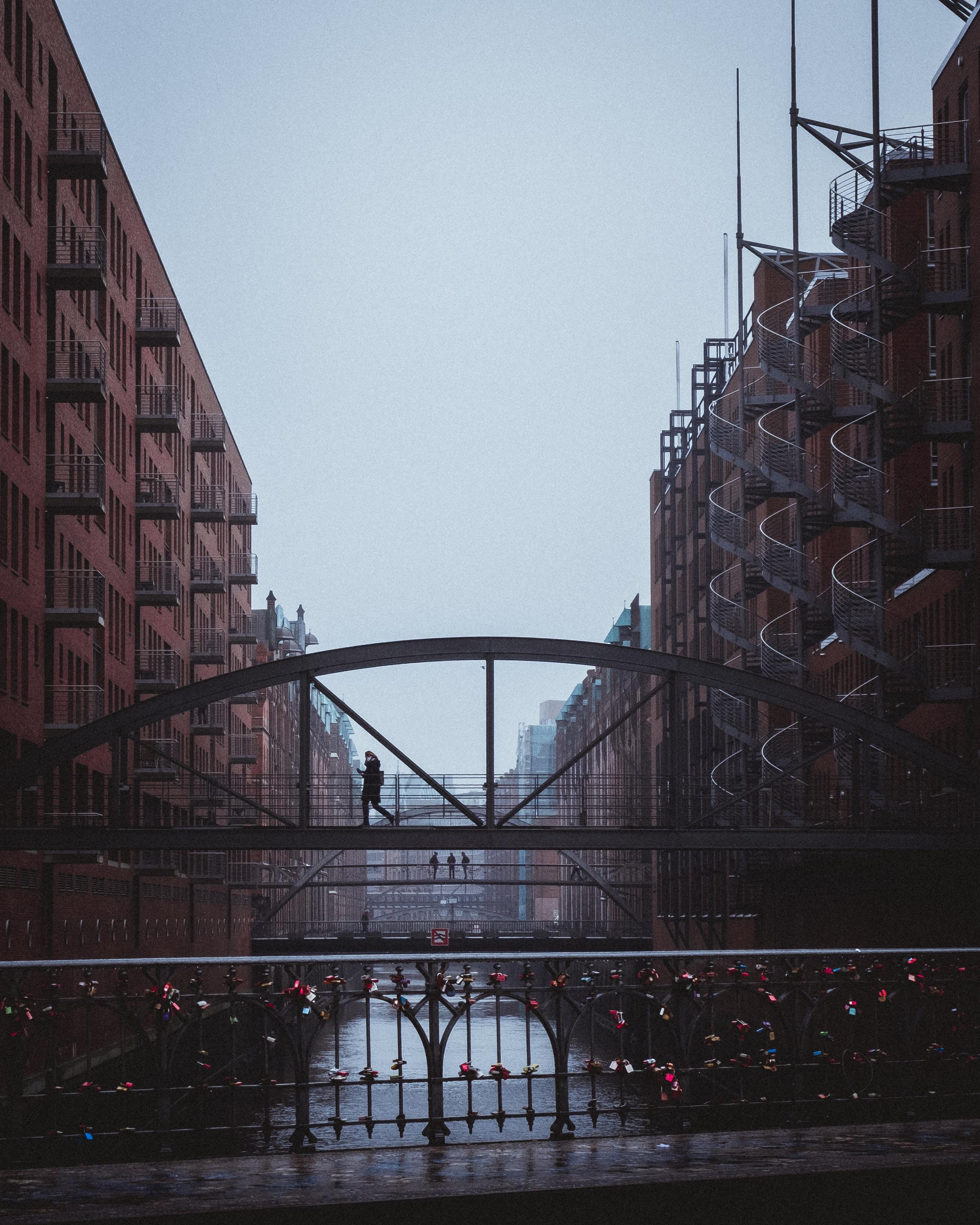 person walking on bridge