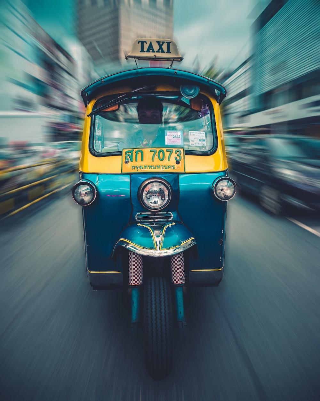 teal and yellow auto rickshaw